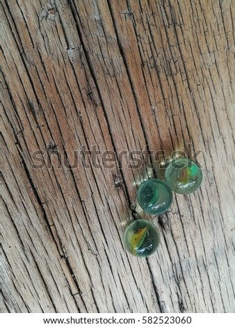 marbles on wood textures