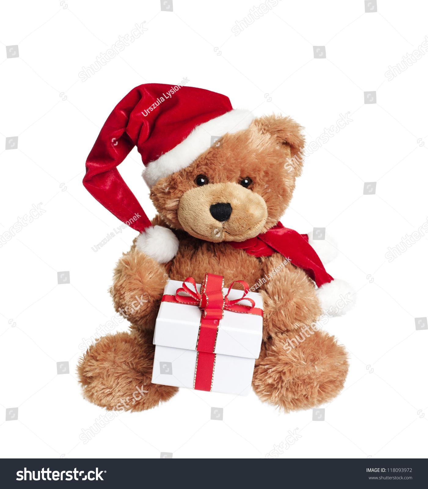 可爱的玩具熊圣诞礼物和圣诞老人的帽子在白色背景
