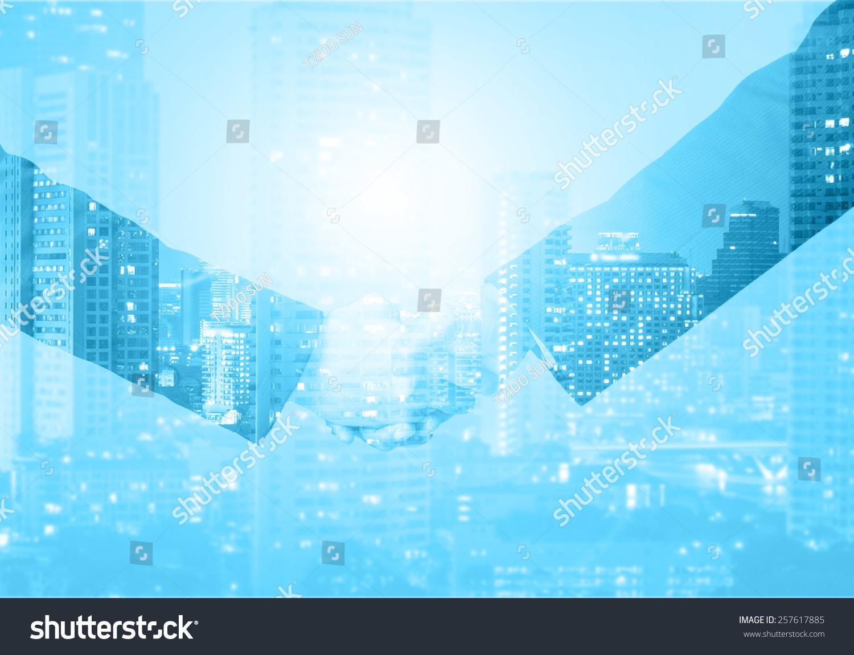 双重曝光握手商人城市背景-背景/素材,商业/金融-海洛