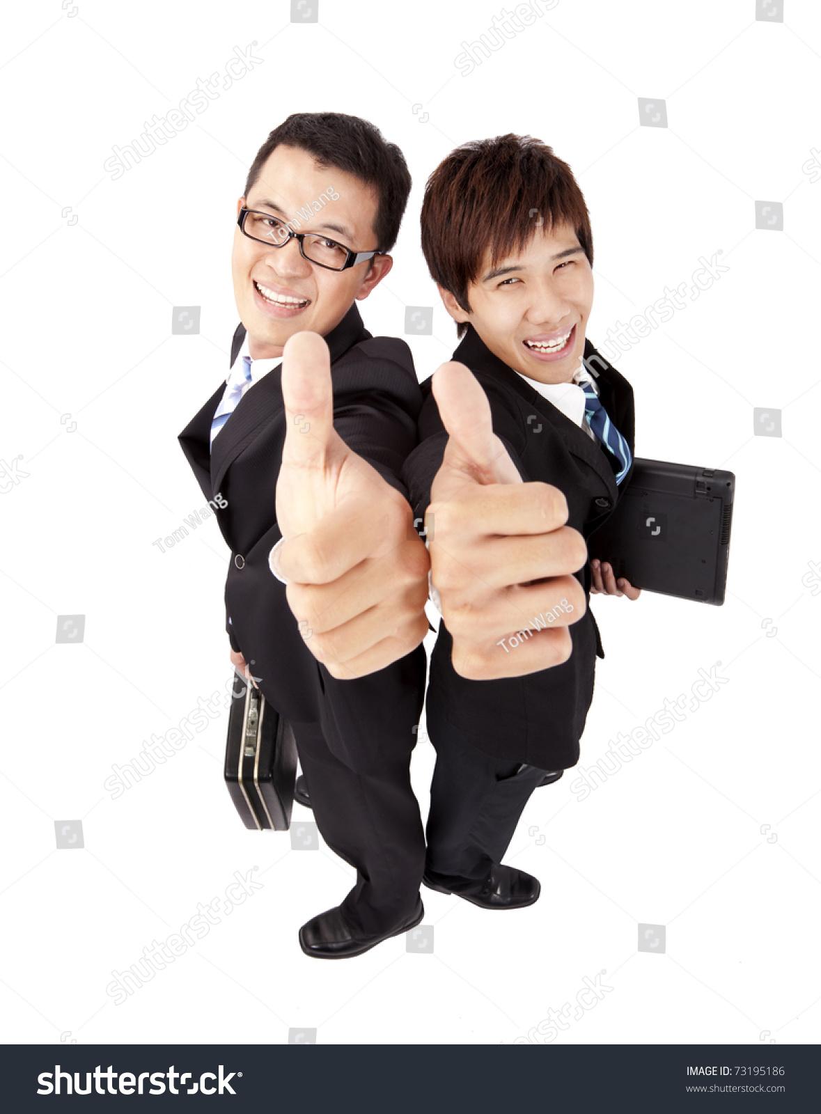 两个成功的商人,伸出大拇指